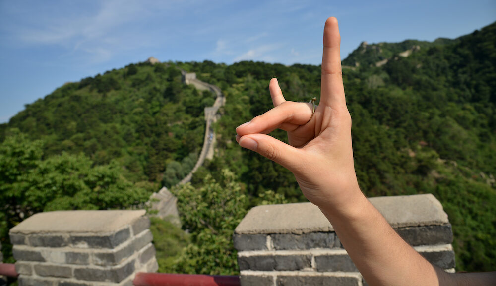 student holds wolf hand sign in china